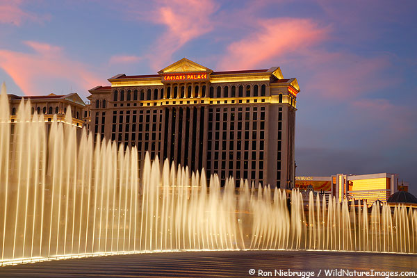 Last nights sunset over Caesars Palace.  The fountains of the Bellagio dance in the foreground, Las Vegas, Nevada.