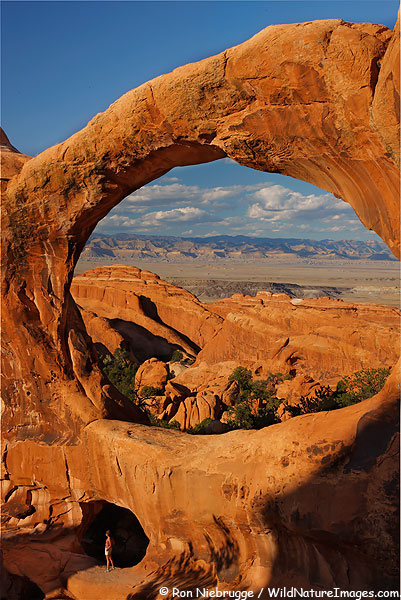 Janine in the lower arch of Double O Arch, Arches National Park, Utah.