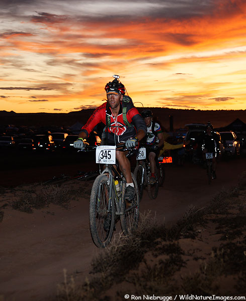 A rider at sunset, 2009 24 Hours of Moab Mountain Bike Race, Moab, Utah.