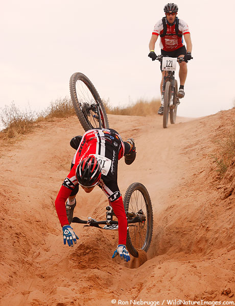 A rider goes head over wheels during the 24 Hours of Moab, in Moab, Utah.