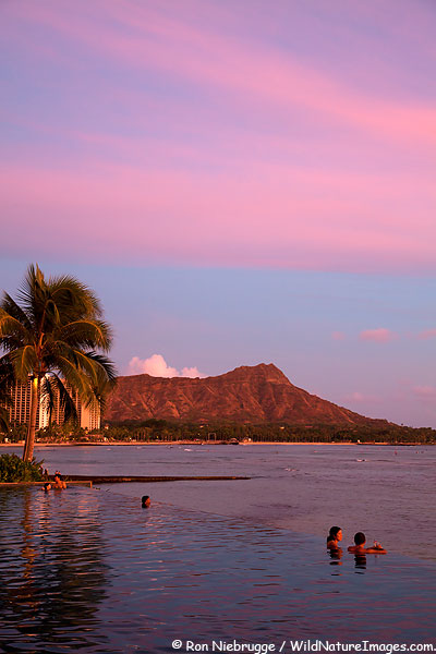 Sunset from the infinity pool at the Sheraton Waikiki, Waikiki Beach, Honolulu, Hawaii.