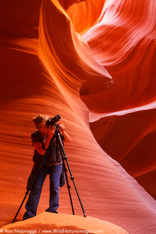 Leah photographing in a slot canyon.