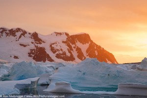 Giant icebergs at sunset, from Booth Island, Antarctica.