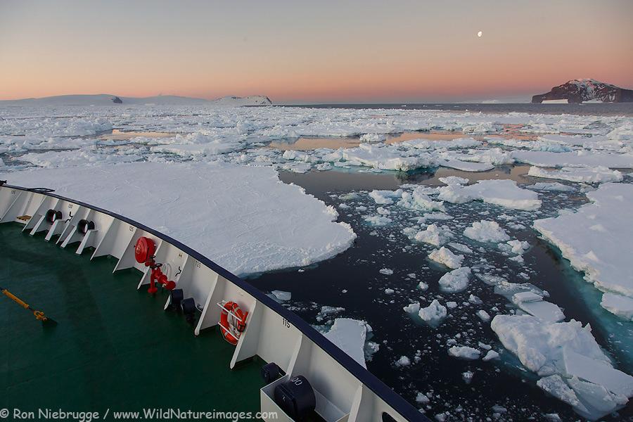 Cruising through the ice at sunset on the Ortelius, Antarctica.