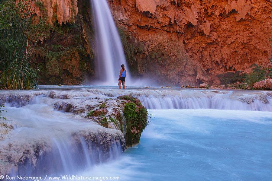 A visitor at Havasu Falls, Havasupai Indian Reservation, Grand Canyon, Arizona. (model released)
