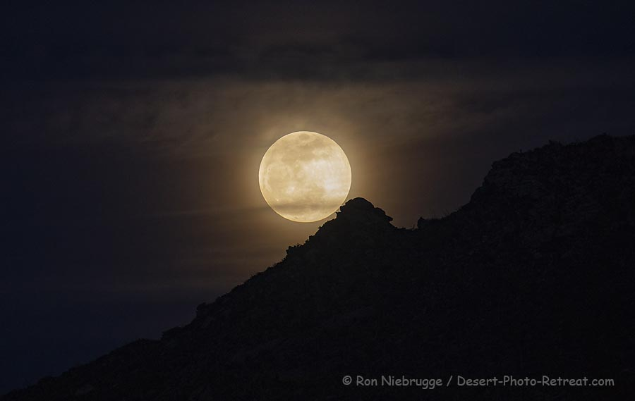 Full moon over the Tortolita Mountains, near Tucson, Arizona.